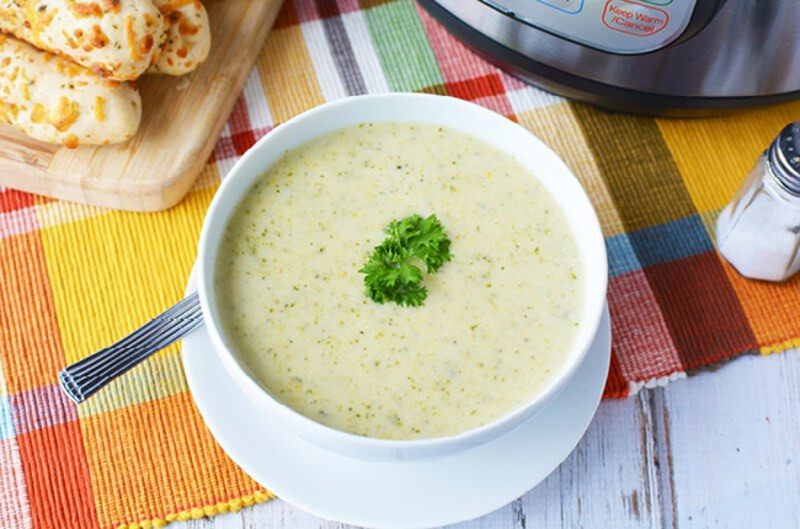 Broccoli cheese soup in white bowl