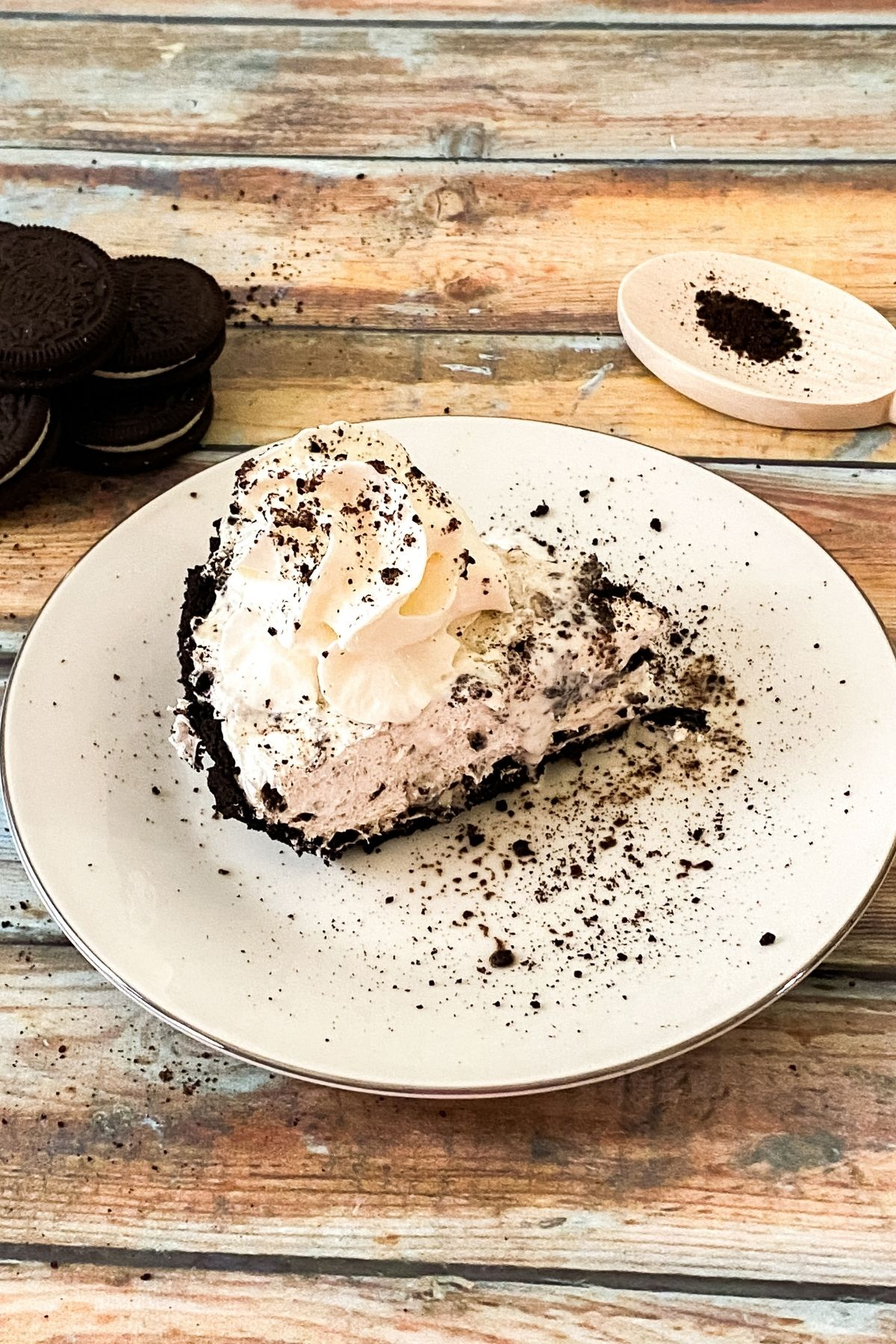 Slice of Oreo cheesecake on white plate