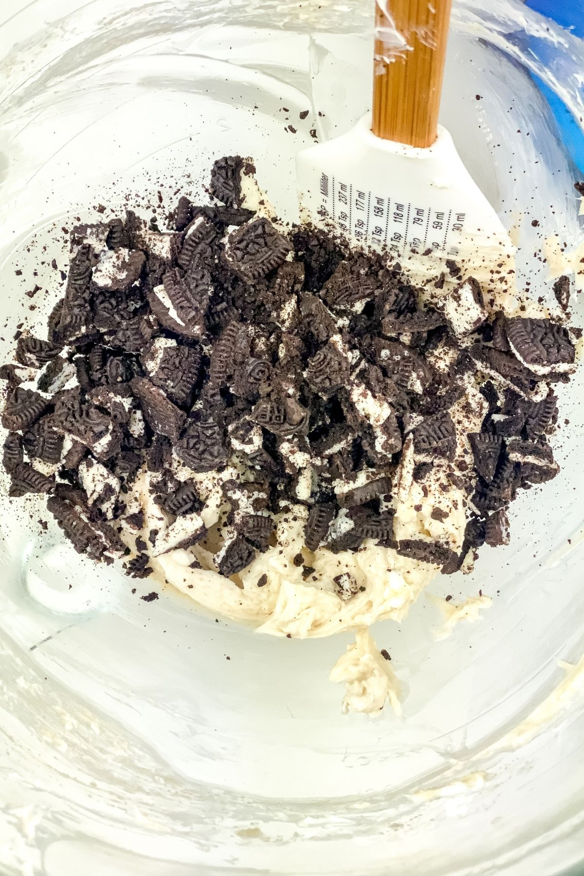 Crushed cookies in bowl of no bake cheesecake
