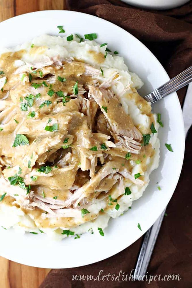 Pork with gravy over potatoes
