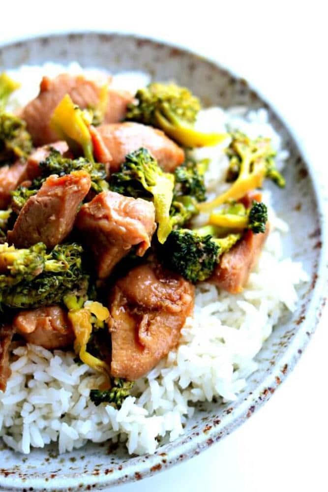 Pork with broccoli over rice