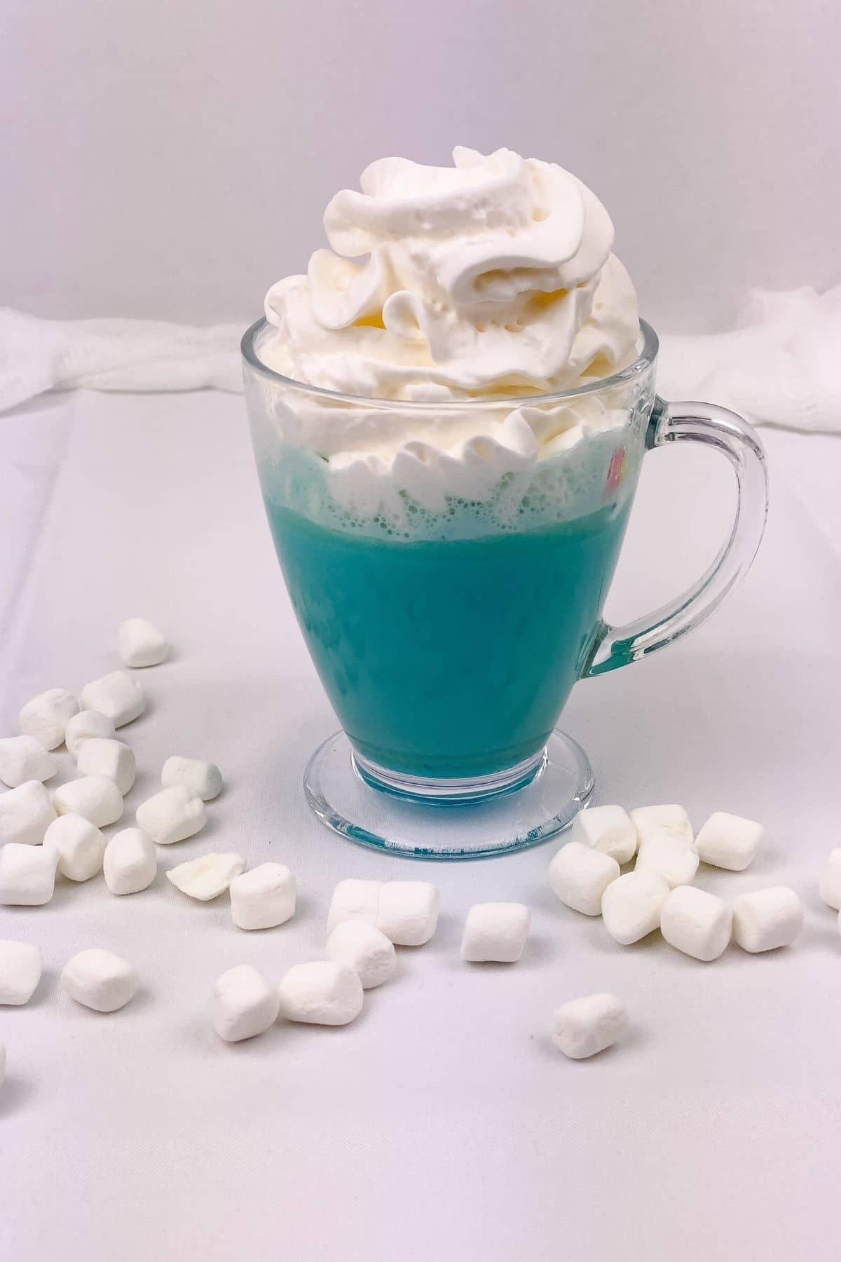 Glass mug of blue cocoa