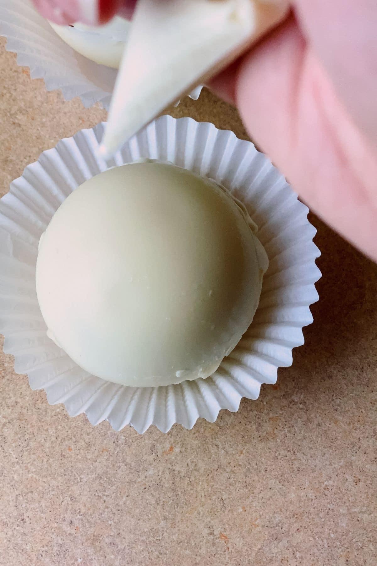 Piping onto white chocolate ball