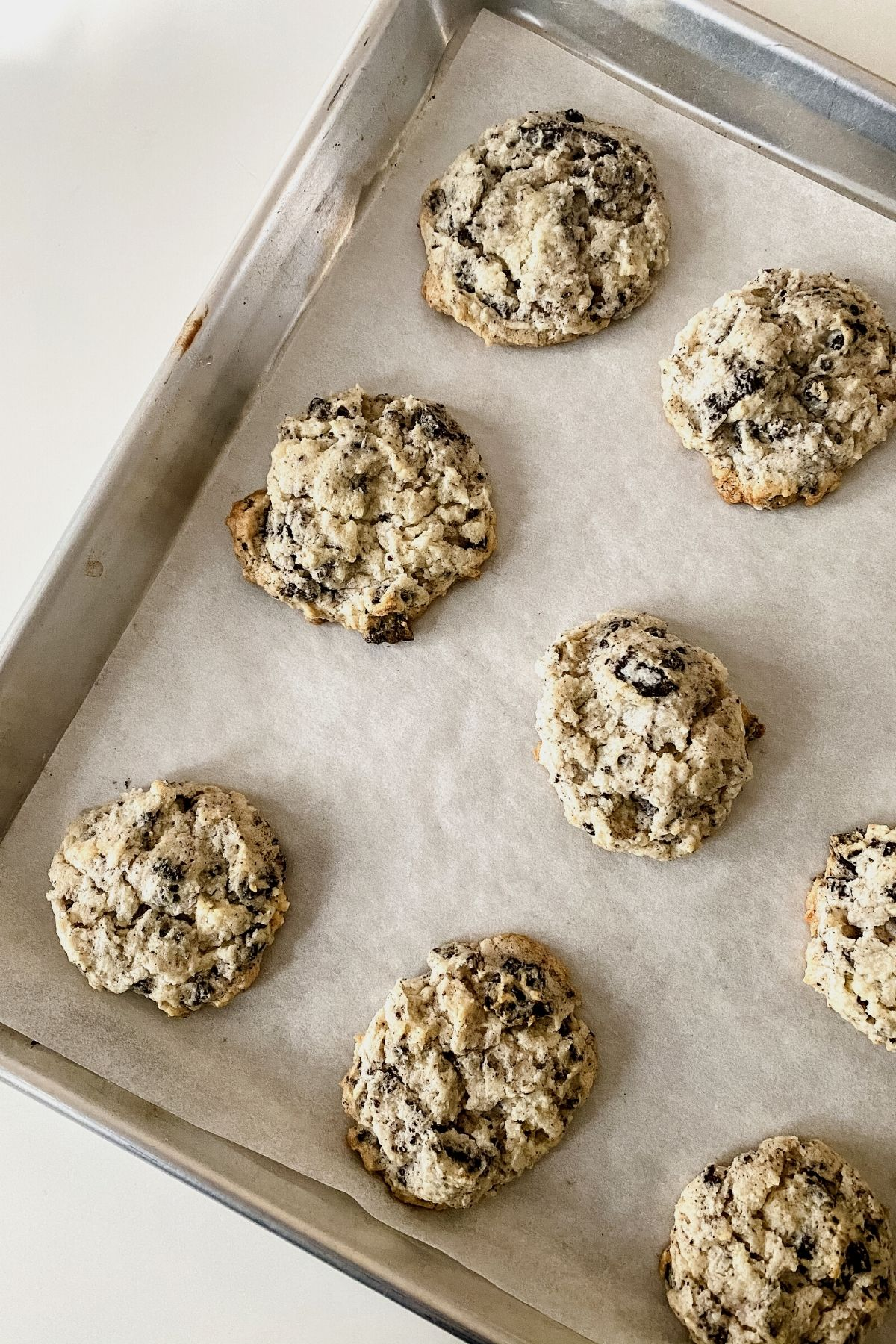 Baked cookies and cream cookies on baking sheet