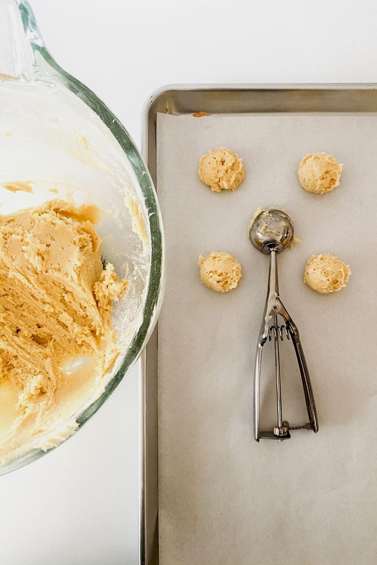 Scooping cookies onto baking sheet