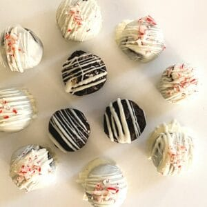 Oreo cheesecake truffles on parchment