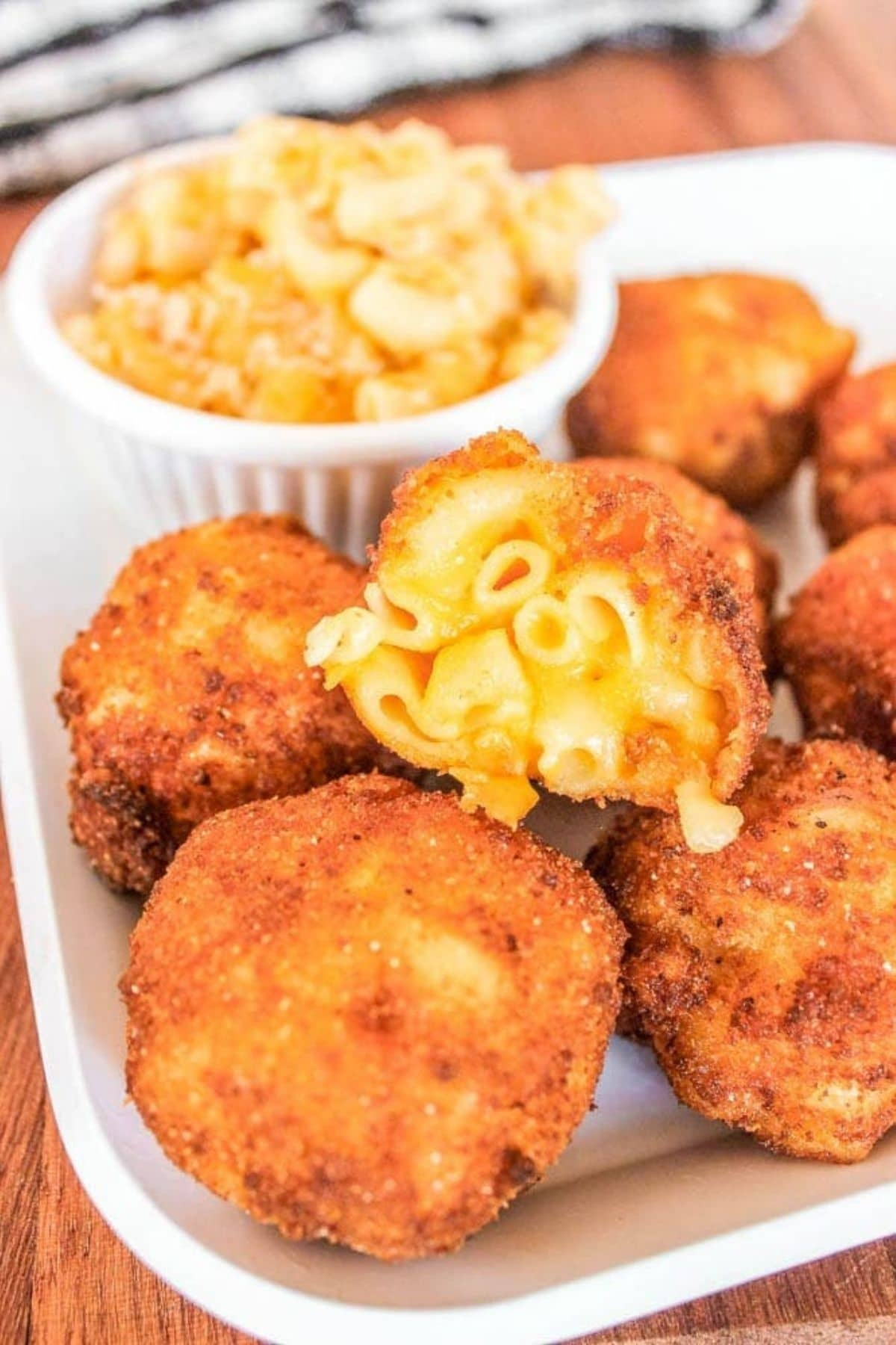 Macaroni and cheese bites on plate