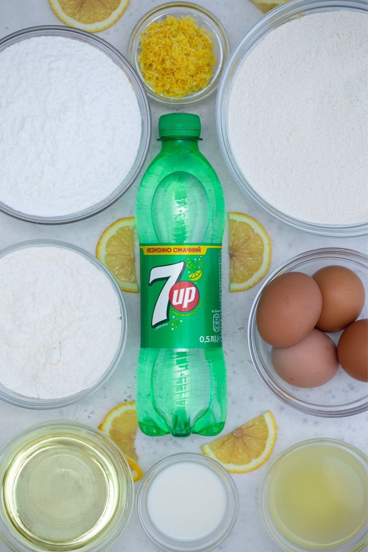 Ingredients for 7-Up cake on white table