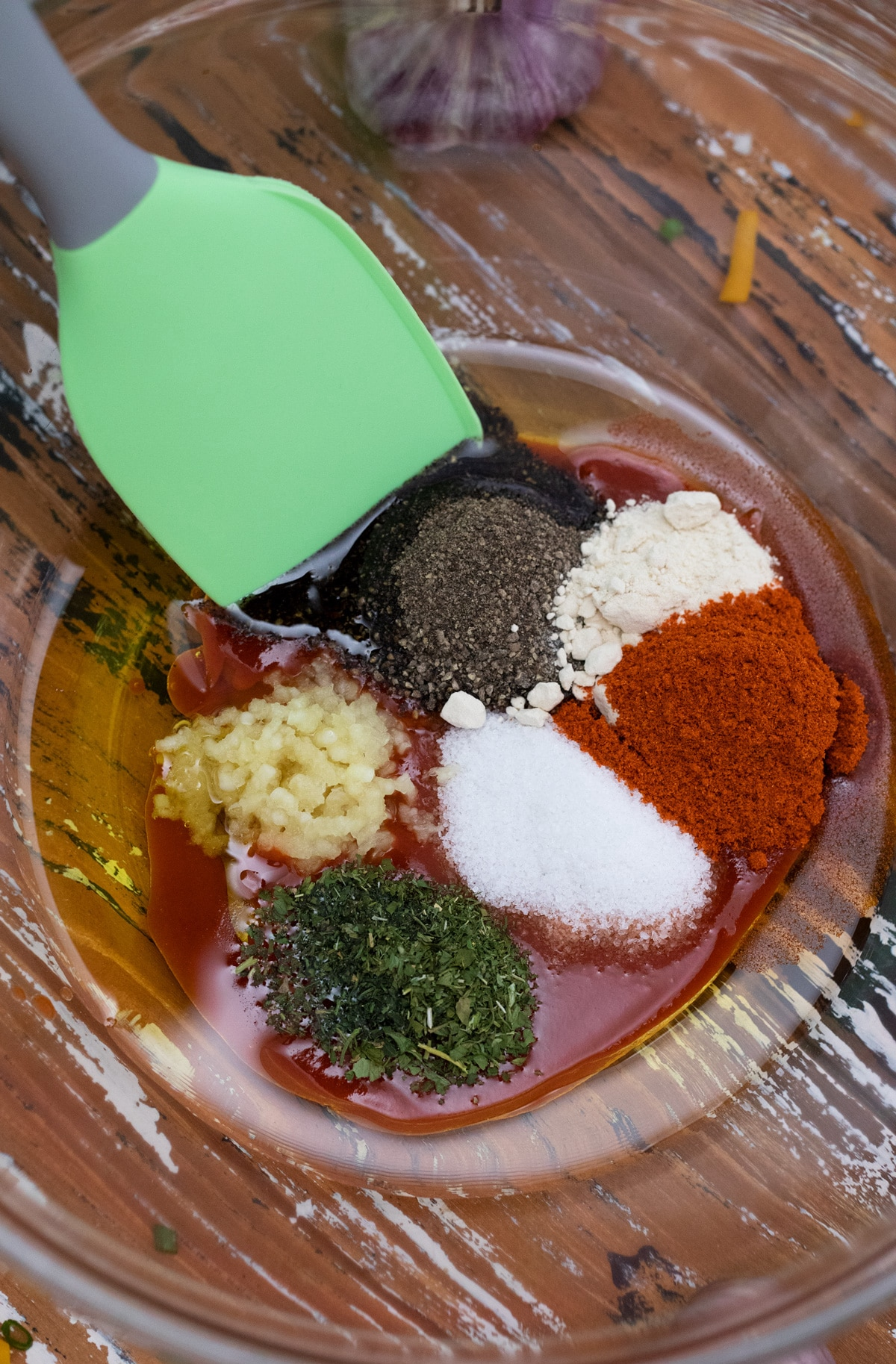 Mixing bowl filled with spices to create sauce