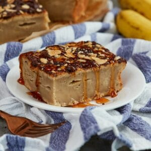 Banana bread blondie on white plate