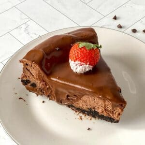Sliced chocolate cheesecake on plates
