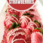 Pink chocolate covered strawberries on tray