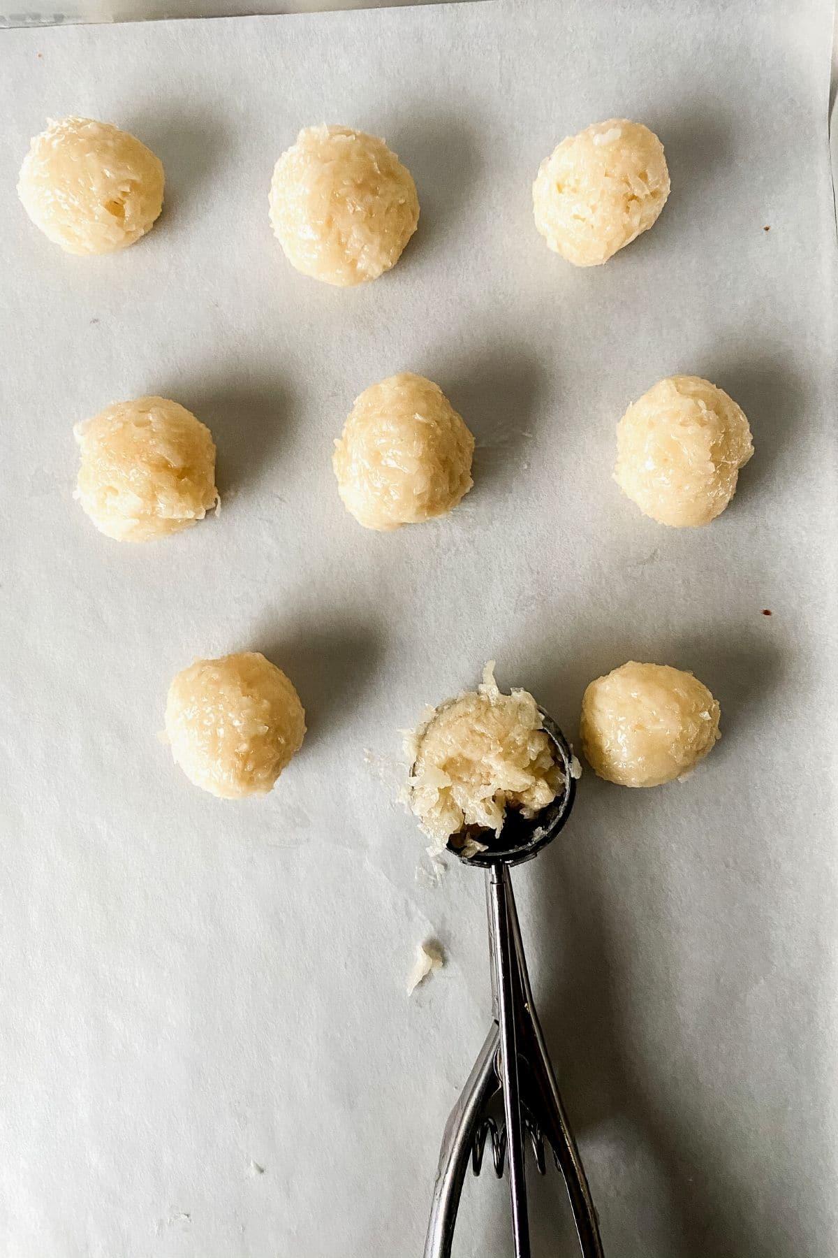 Coconut truffles on baking sheet
