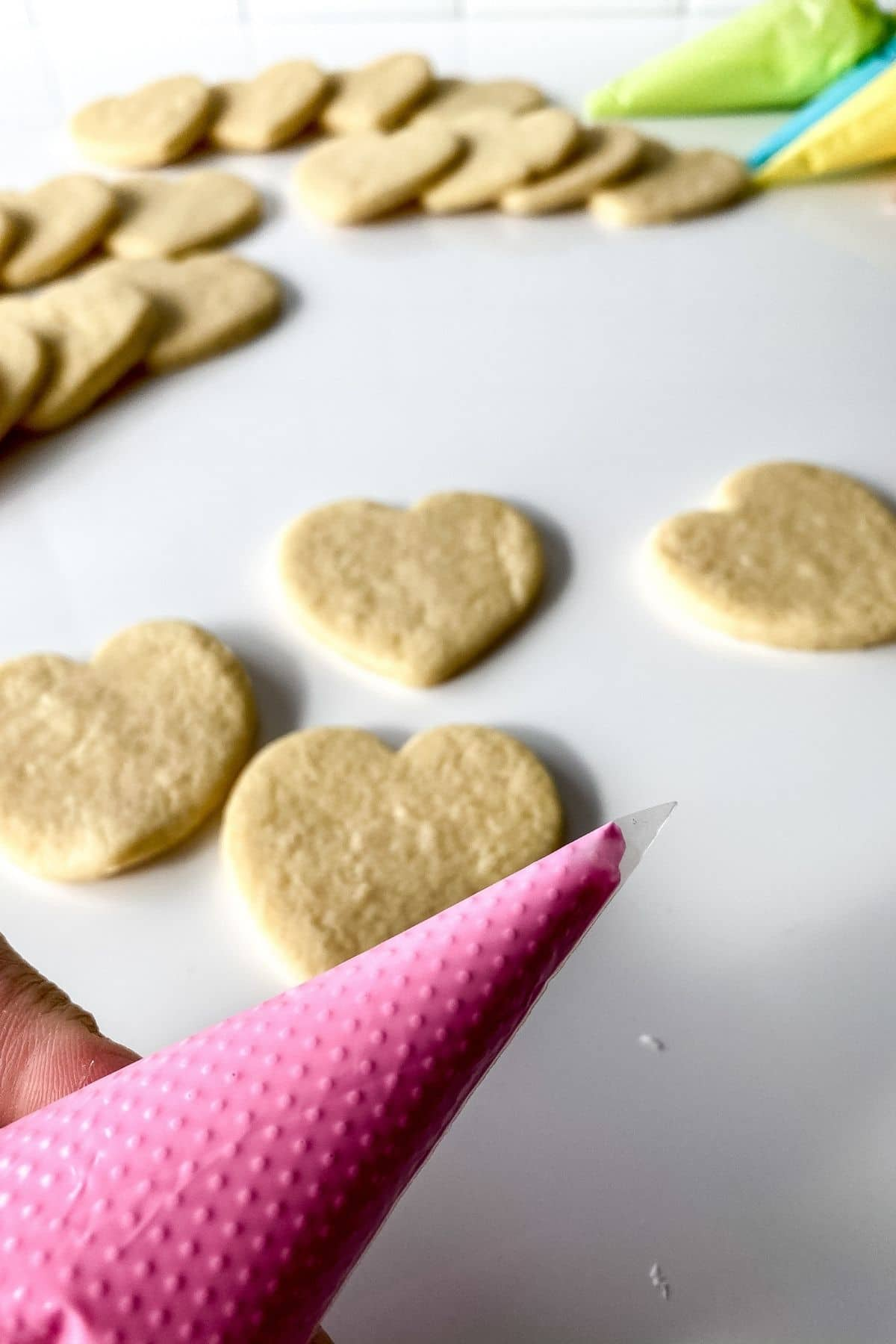 Piping icing onto cookies