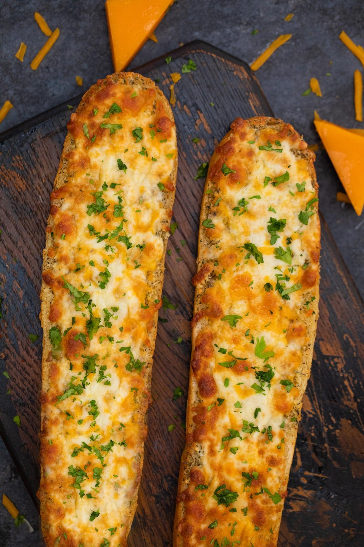 Loaf of garlic bread on wood