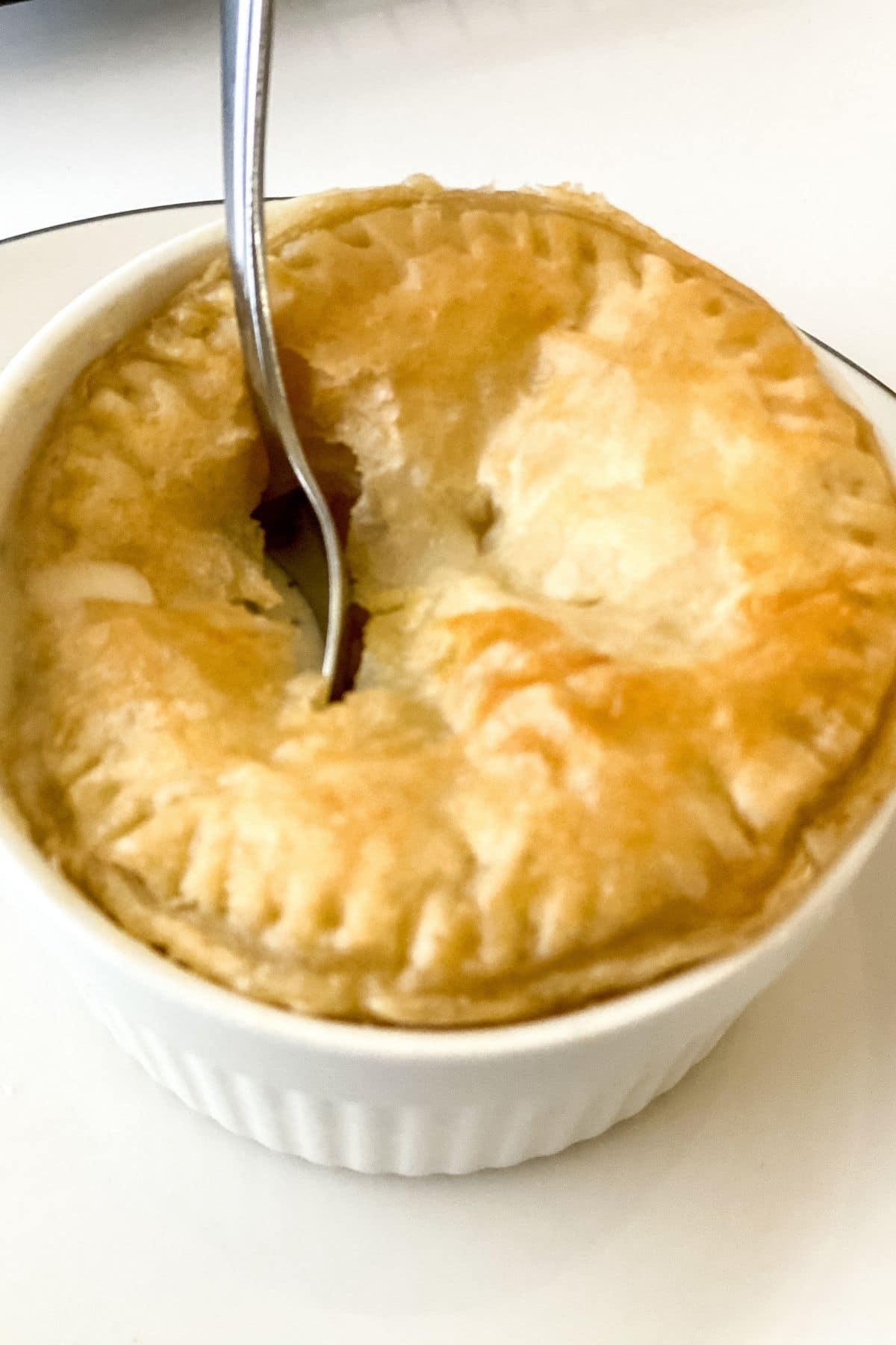 Spoon in pot pie