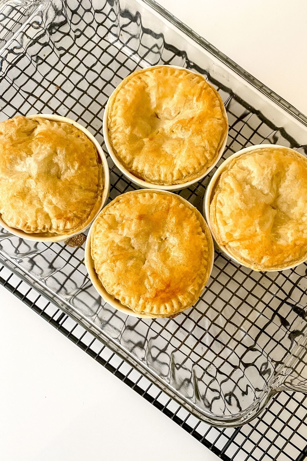 Baked pot pies on wire rack