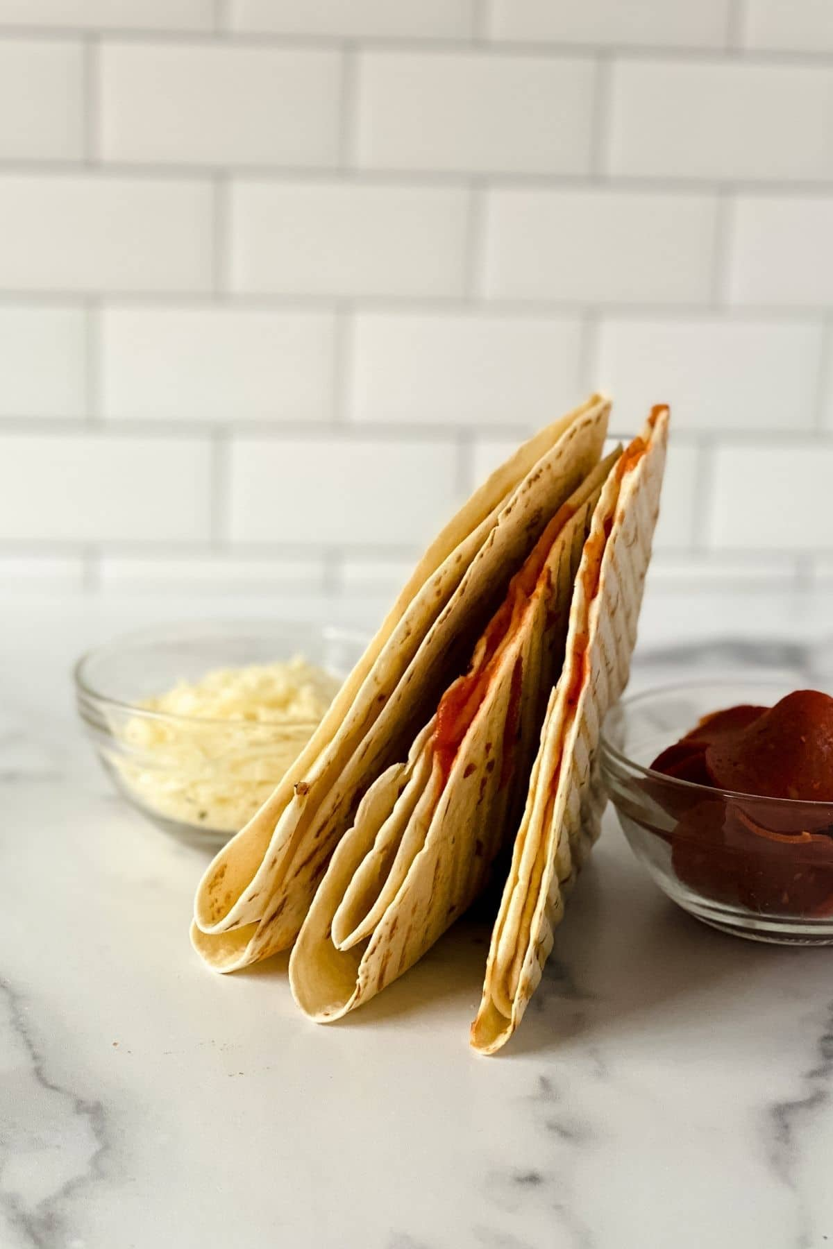 Stack of pepperoni pizza wraps