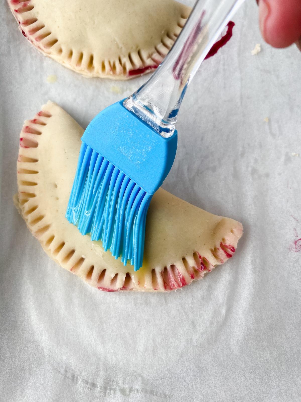 Egg washing hand pies