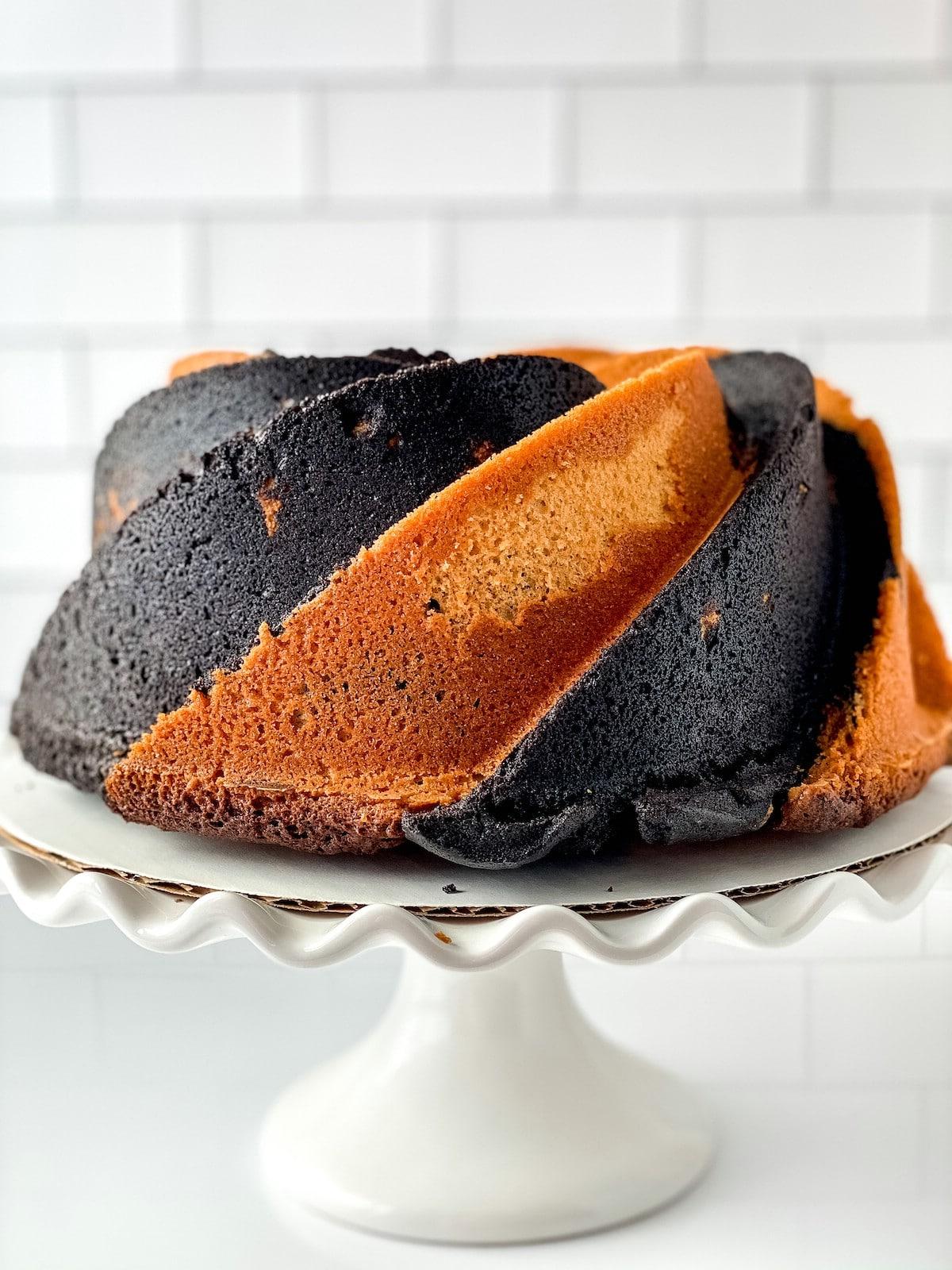 Baked black and orange cake on cake stand