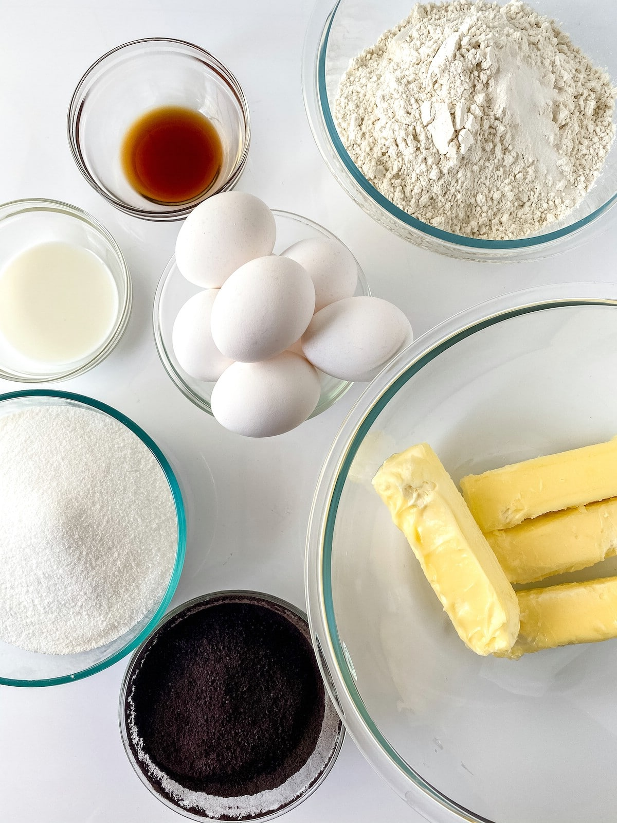 Ingredients for vanilla chocolate cake in clear bowls