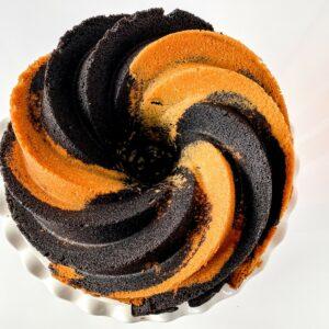 Chocolate vanilla swirl bundt cake on cake stand
