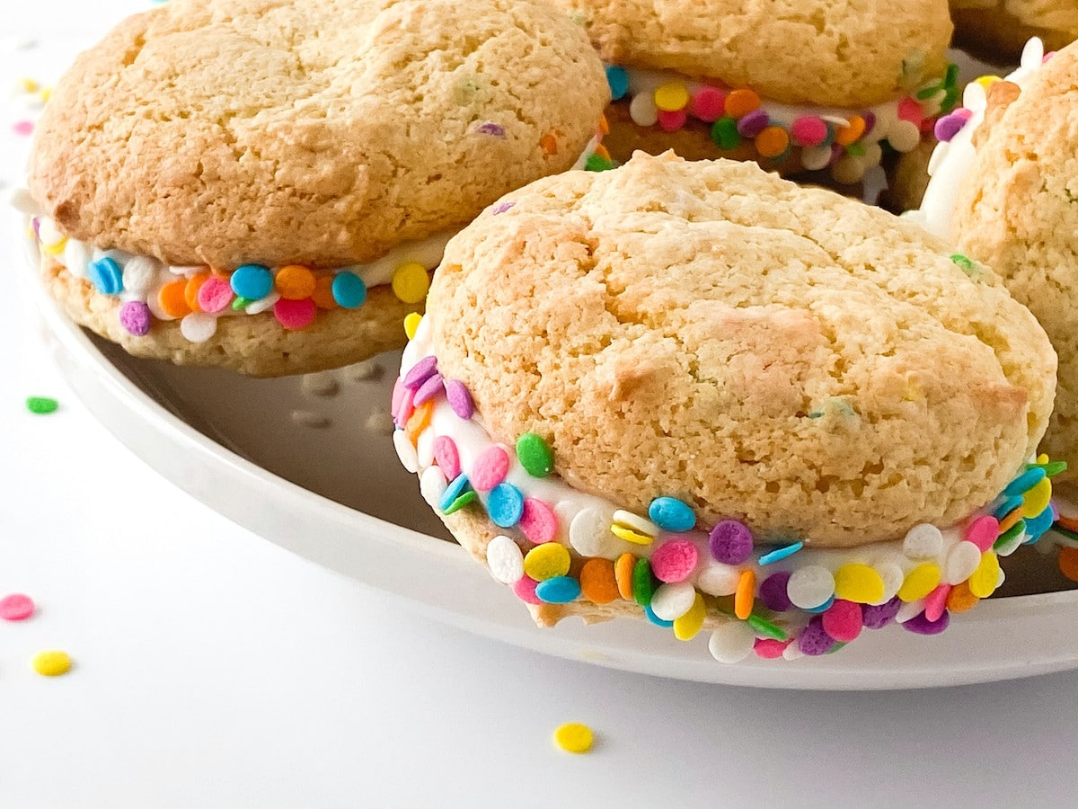 Confetti sandwich cookies stacked on platter