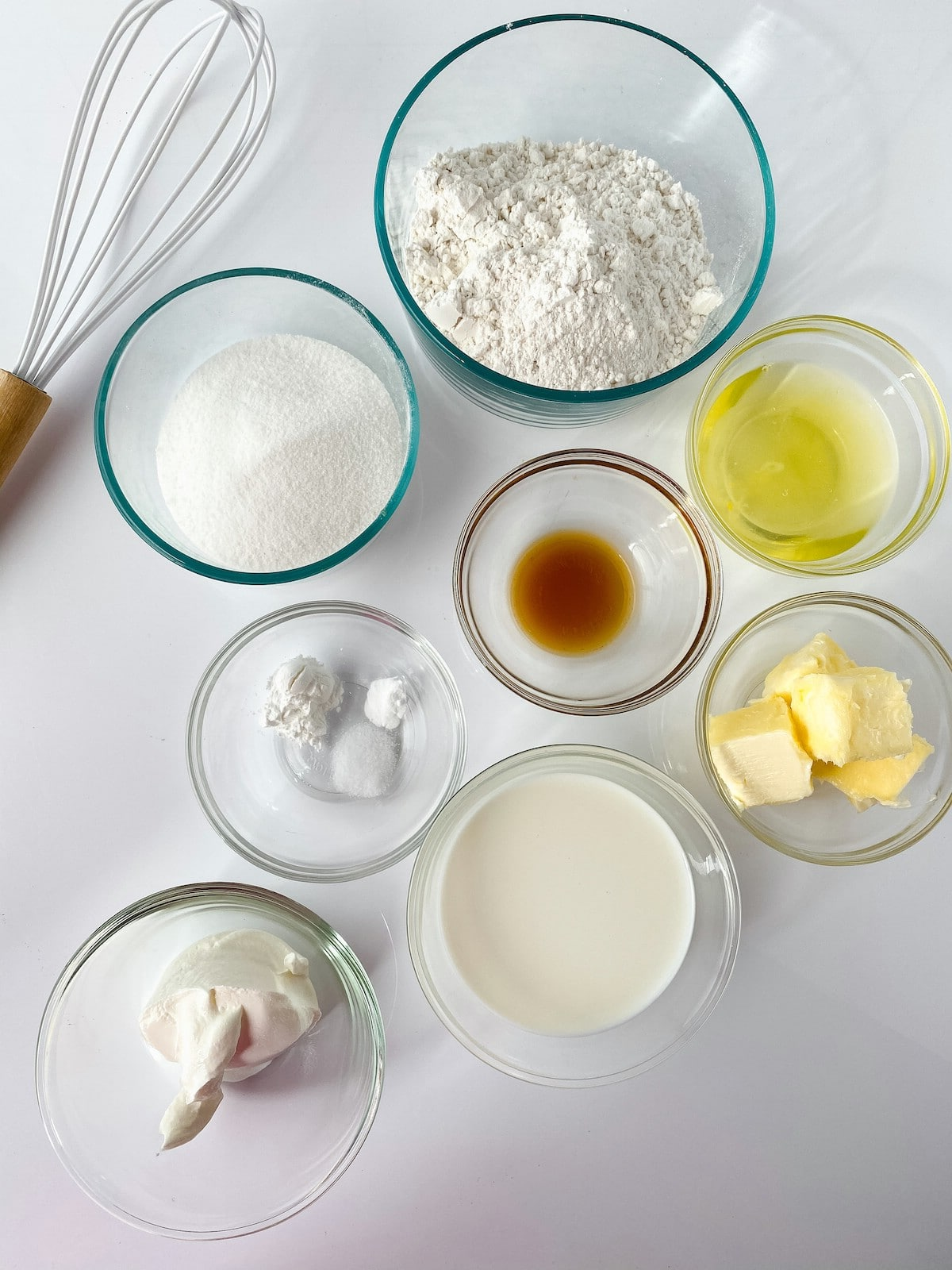 Ingredients for cupcakes in bowl on white counter