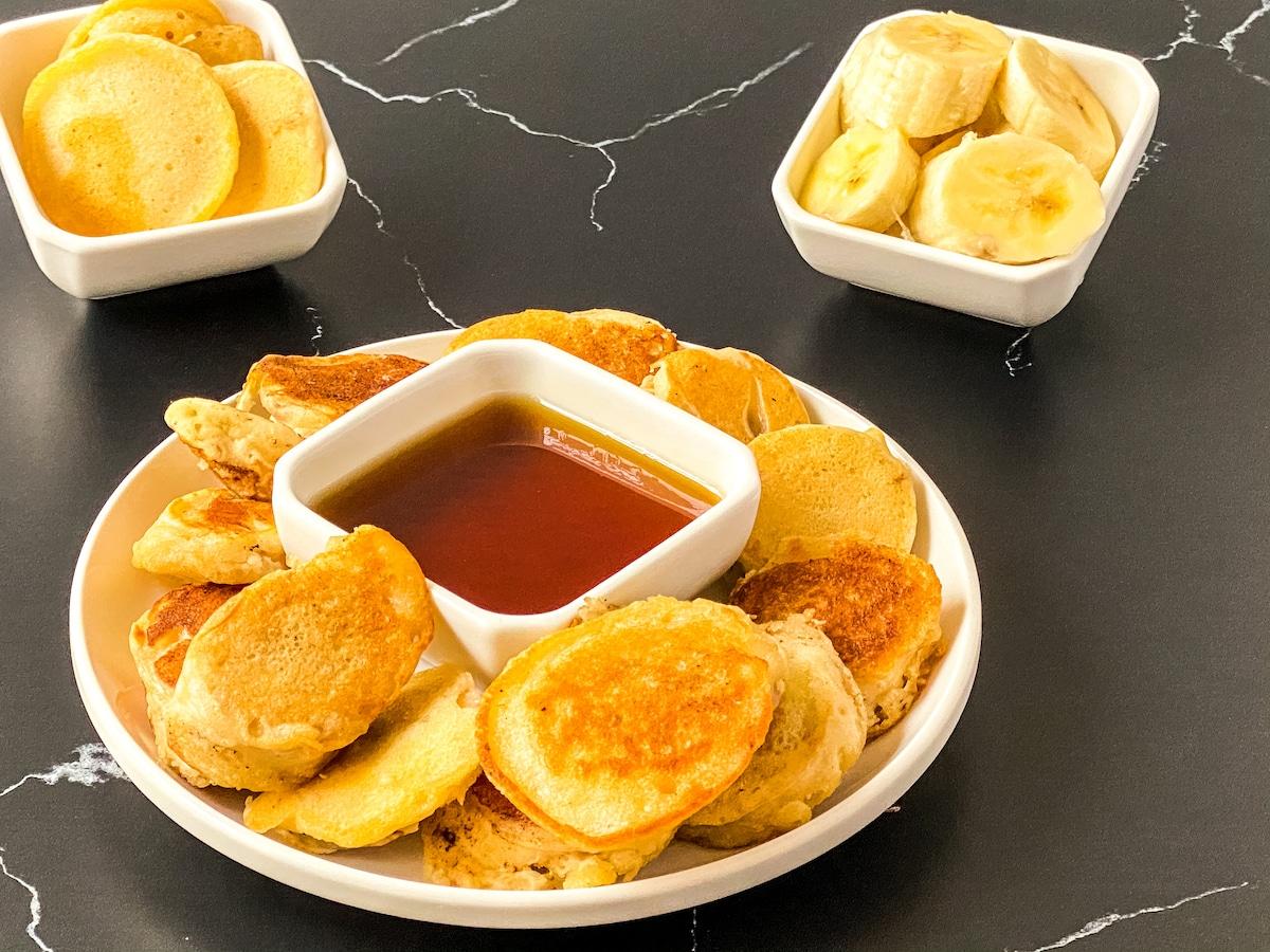 Banana pancake dippers on white plate