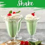 Tall clear glasses of green milkshake topped with cherry