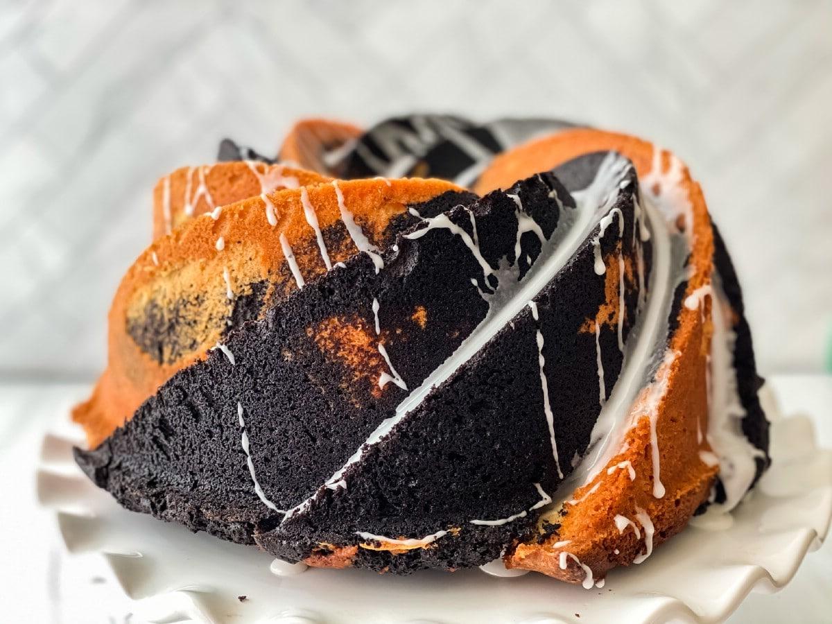 Swirl bundt cake on stand with glaze