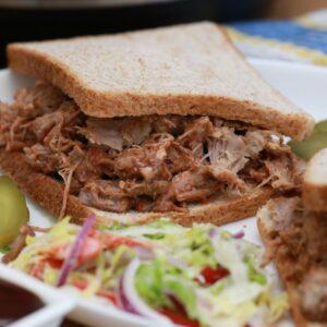 Pork sandwich on wheat bread