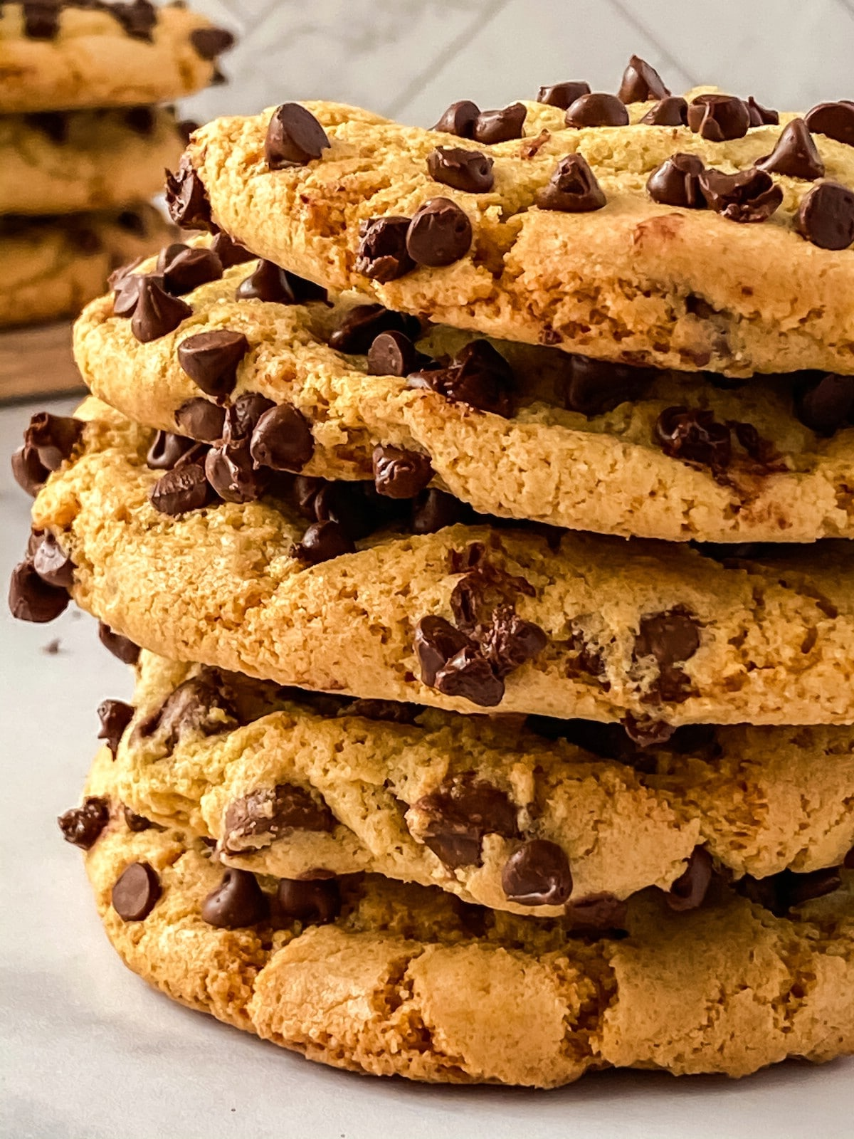 Tall stack of chocolate chip cookies