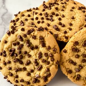Stack of chocolate chip cookies on white counter