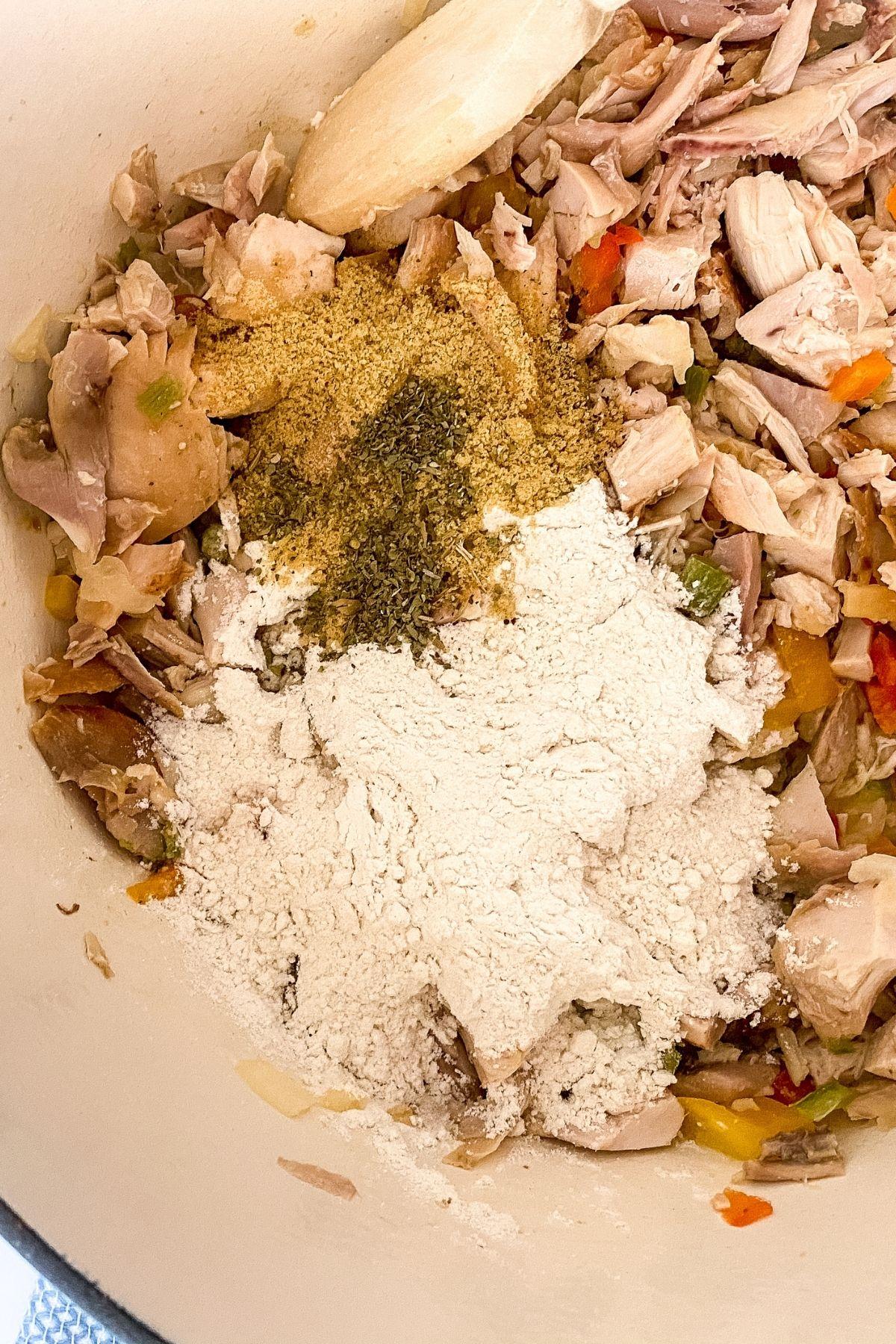 Adding chicken to pot pie