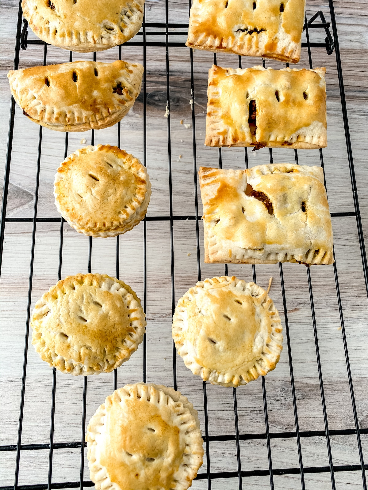 Meat pies on wire rack