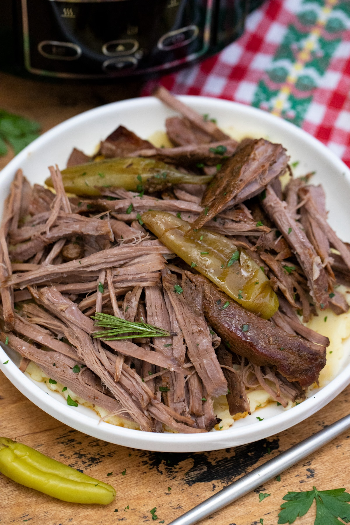 Mississippi pot roast in white bowl