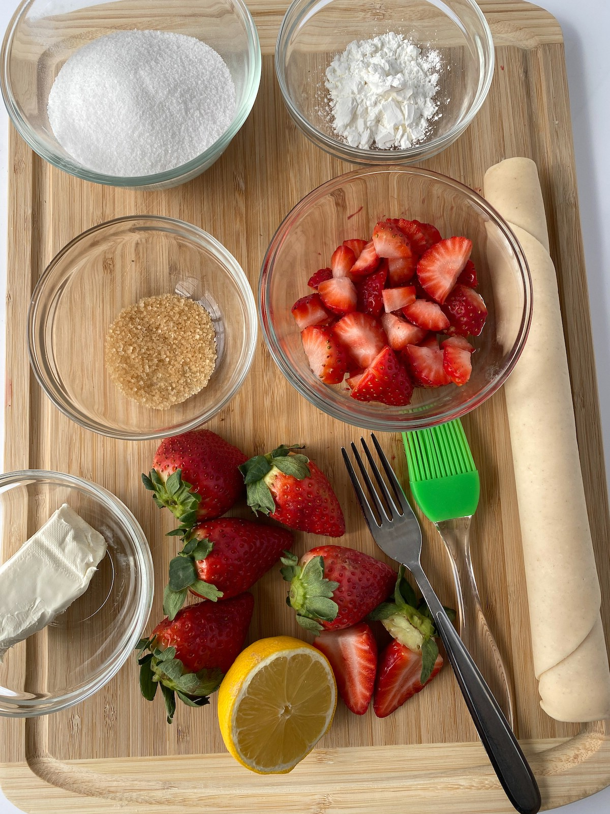 Ingredients for strawberry hand pies laying on cutting board