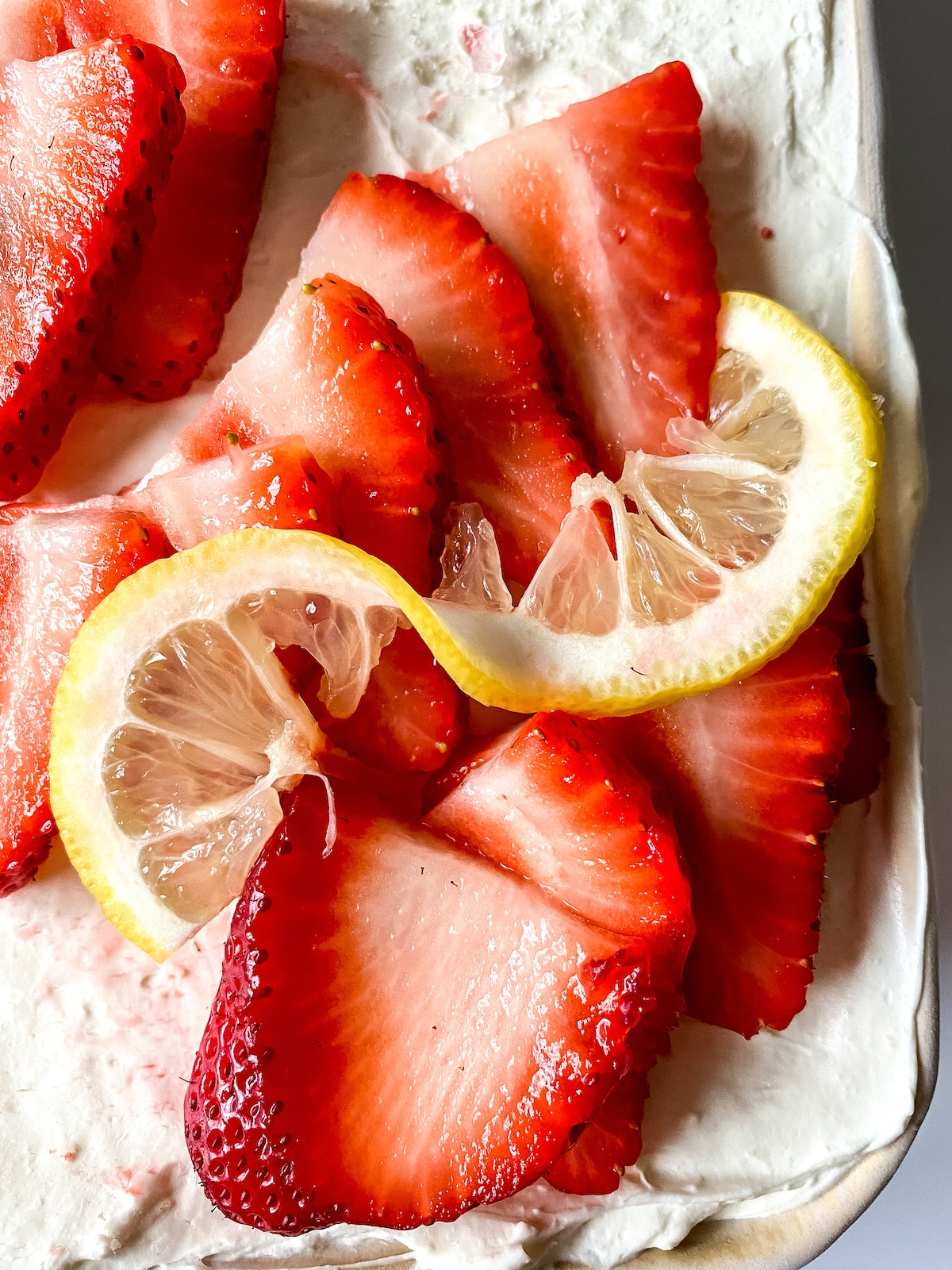 Lemon cheesecake with strawberry and lemon slices on top