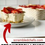 Slice of cheesecake with strawberries on white saucer