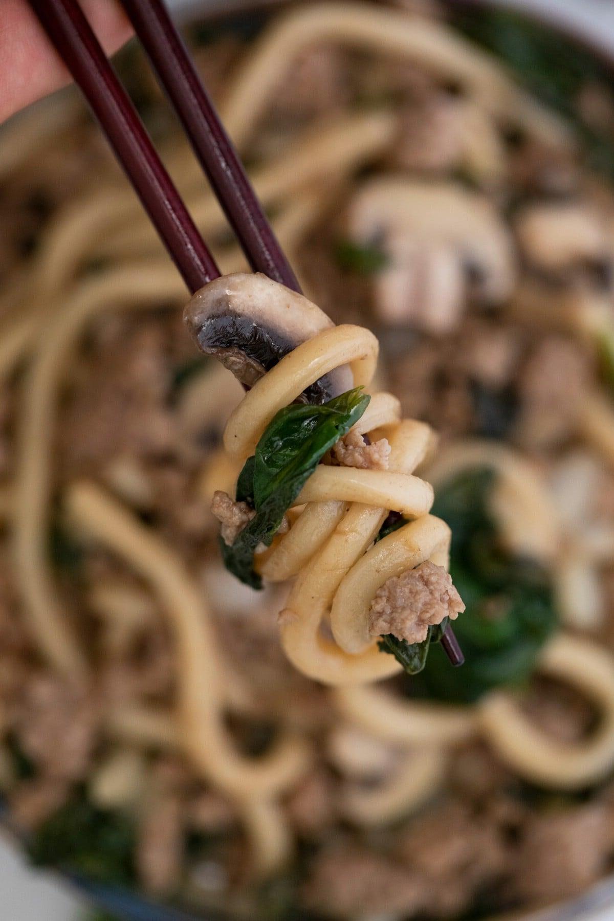 Stir fry noodles on chopsticks