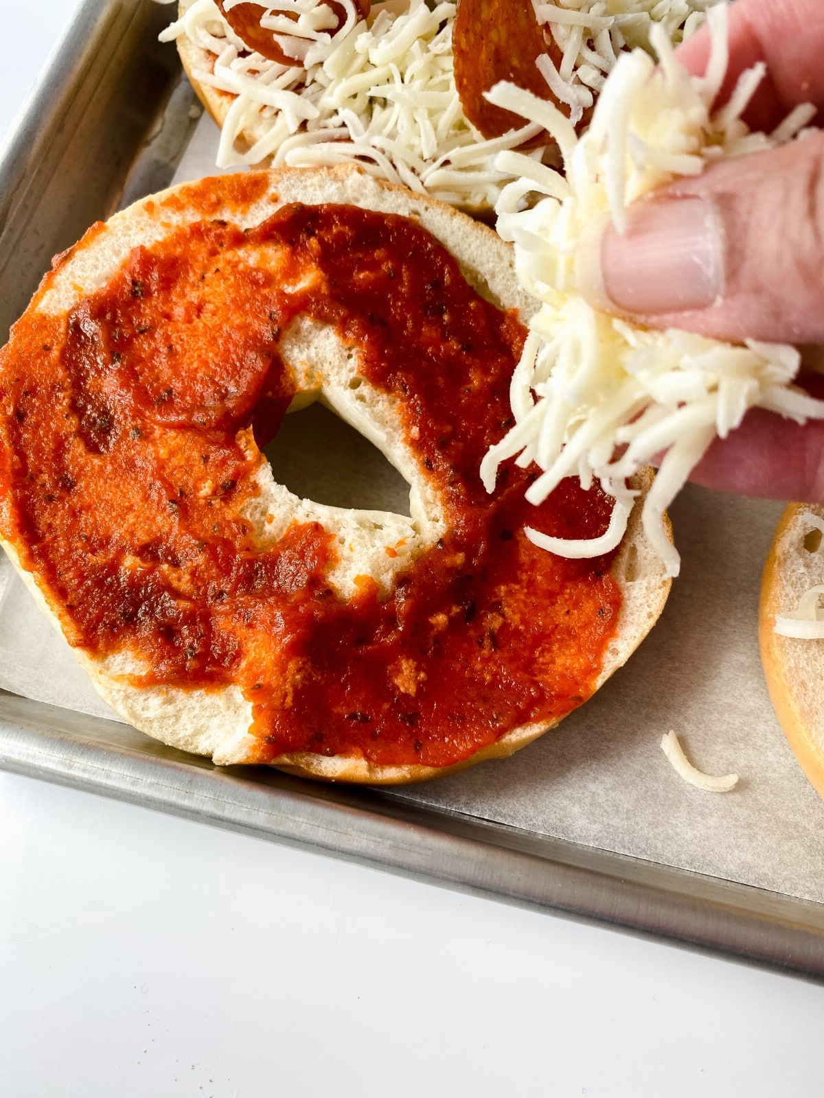 Adding cheese to bagel
