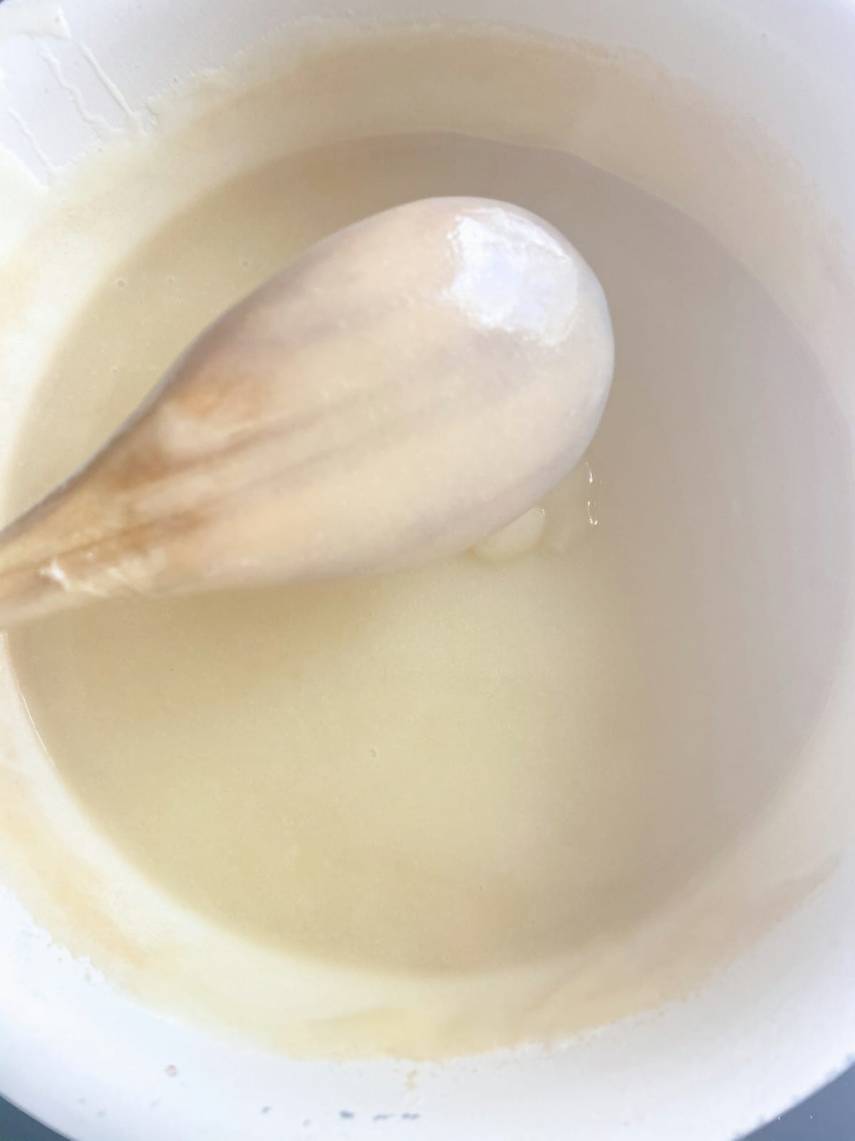 Pudding coating the back of a spoon