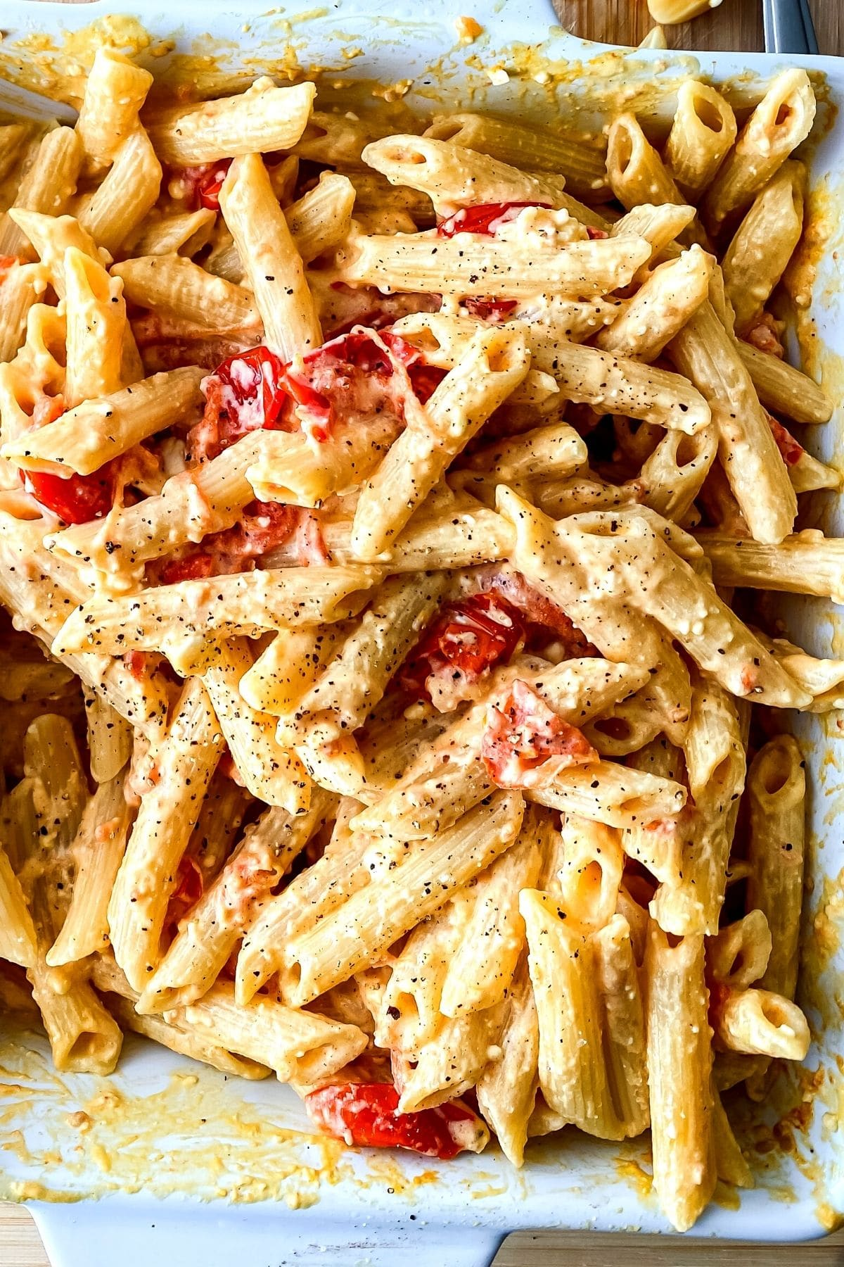 Dish of baked pasta on cutting board