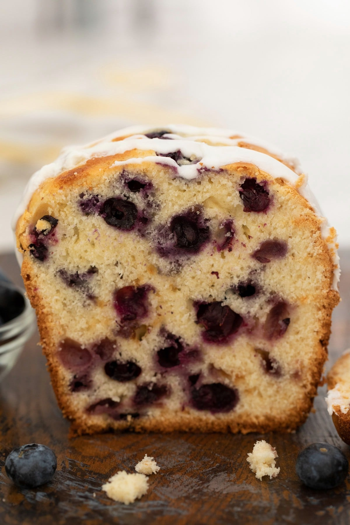 Slice of blueberry bread on cutting board