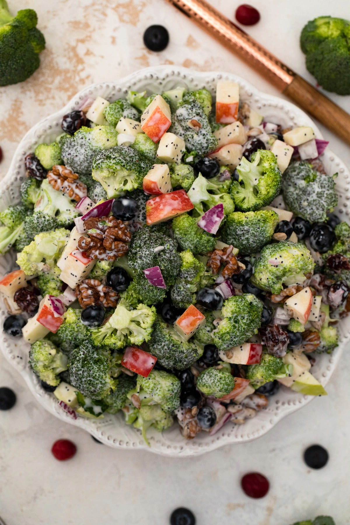 White bowl filled with broccoli salad