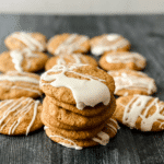 Brown butter cookies with icing on black surface