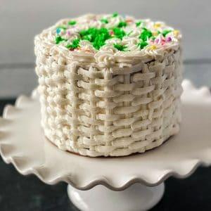 White basket weave cake on white cake stand