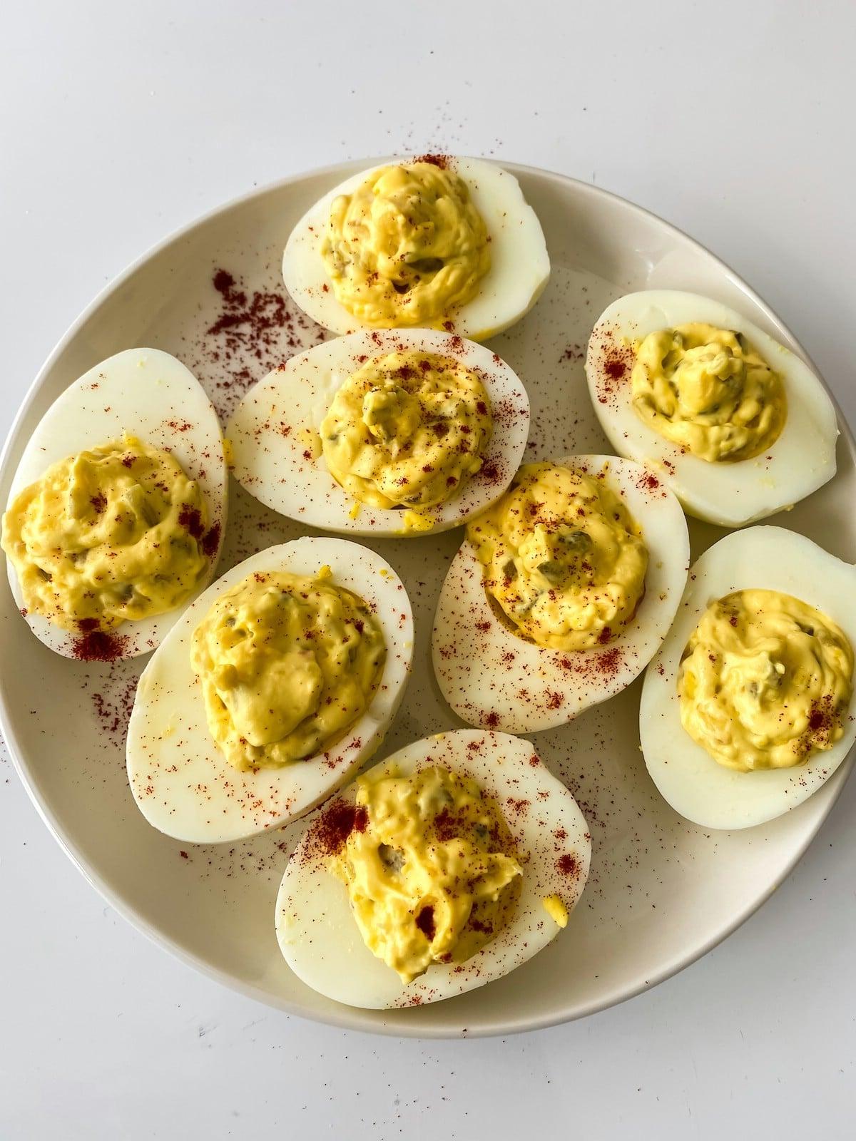 Deviled eggs on white plate