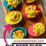 Cutting board with blue yellow and pink deviled eggs